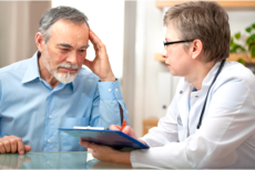 Male senior and a doctor during a consultation