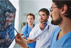 Doctor and specialists analyzing an x-ray result